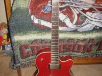 This is a pre-owned Dean Stylist acoustic/electric