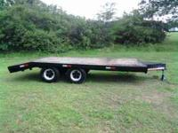 Heavy duty trailer, has portable ramps that are also