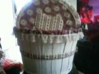 I have a decorated bushell basket with lid. Perfect for