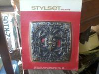 New in package Decorative metal switch covers. $2 each,