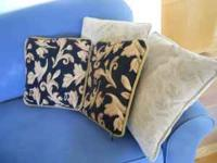 These are 4 decorative pillows, perfect for bed or