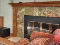 This is a solid oak wood fireplace mantel and side