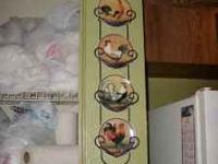 I have 2 identical Wall Hangers with Ceramic Plates,