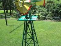 This is a brand new Decorative Windmill for your garden