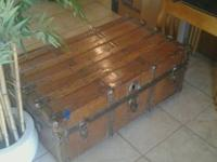 This is a lovely, decorative, wood and leather chest.