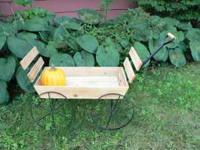 Decorative wood and metal planter cart. Excellent