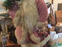 This gorgeous Santa stands on his own and is stuffed as