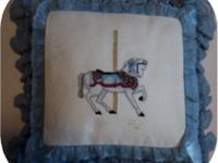 I have 3 handcrafted carousel equine x-stitch pillows
