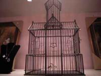 NEW MERCHANDISE- this is a large decorative bird cage