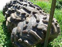 4 Matching Titan ATV tires mounted on wheels:589 m /