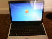 black and silver dell inspiron 1440. works good about a