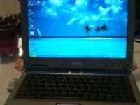 Dell laptop Inspiron 1100, with windows xp. Has wifi,