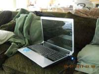 THIS IS A USED DELL LAPTOP.. IT IS STILL IN REALLY NICE