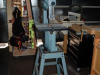 "Delta 10"" band saw with stand, saw blades and table"