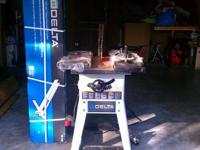 "Here's a 10"" delta table saw that was only used once to"