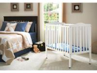 Delta folding portable mini crib with Babyletto