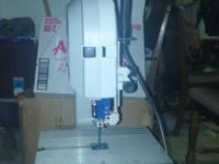 Great band saw with work light attached. Near new. Call