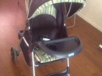 Navy stroller with Green plaid accents Immaculate