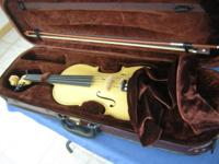 Excellent blonde (clear finish) full-size violin.