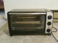 nice deluxe toaster oven. very clean. works great. two