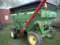 Demco 365 Gravity Wagon with seed auger. Trails good.