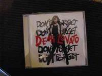 i am selling 2 Demi Lovato CDs: Dont Forget and Here We