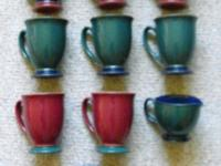 Eight mugs colors blue, red and green, with matching