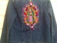 Hip, chic denim blazer or jacket embellished with