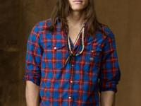 This madras shirt features Western-style detailing and