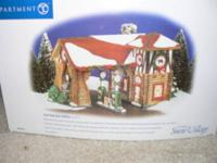 OFFERED IS A DEPARTMENT 56 SUPER SUDS LAUNDROMAT FROM