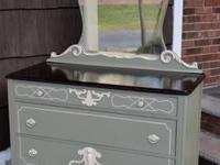 This dresser with mirror was hand painted in warm