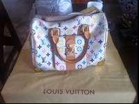 I have nice designer bags, this Louis Vuitton white