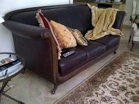 --- FROM CARL'S FURNITURE. DARK BROWN LEATHER COUCH.