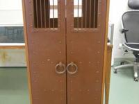 Small metal double door with cast iron legs and bars in