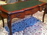 Highly polished Louis XV-style desk with bronze mounts.
