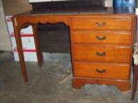 Solid wood desk. Polyurathane finish. Call . Location: