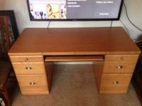 This is a very solid, sturdy desk in good shape.
