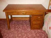 Can be used as a drafting table also. Made of oak and