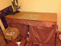 Tan desk for sale.  Has removable place mat on top and