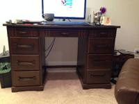 Beautiful, sturdy desk for sale.  Dark colored wood,