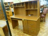 Huge workdesk has a hutch. Great health condition