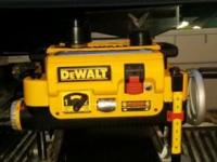 For sale dewalt wood planer use a few times. Comes with