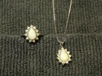 Diamond and Opal ring and pendant locket set.  These 2