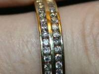 14kt yellow gold, .52ctw round diamond band, sizable 7.