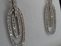 These are lovely white gold diamond earrings. With a