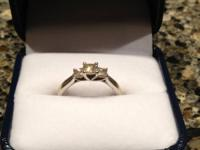 3 stone princess cut diamond ring for $995.  0.75 TCW