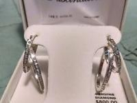 A beautiful set of diamond earrings that would make any