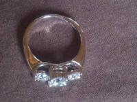 I have a beautiful white gold 3 stone diamond ring with