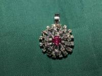 I am selling my 14k diamond ruby pendent. It is 14k