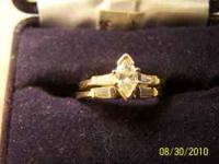 This is a 1/2 Carat Marquis Diamond center stone
